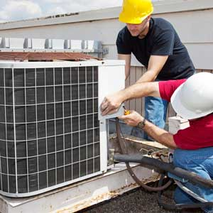 Men Repairing Air Conditioning Unit